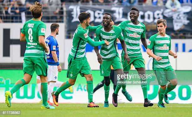 Lamine Sane of Bremen celebrates the first goal for his team with Ousman Manneh of Bremen, Clemens Fritz of Bremen and Fin Bartels of Bremen during...