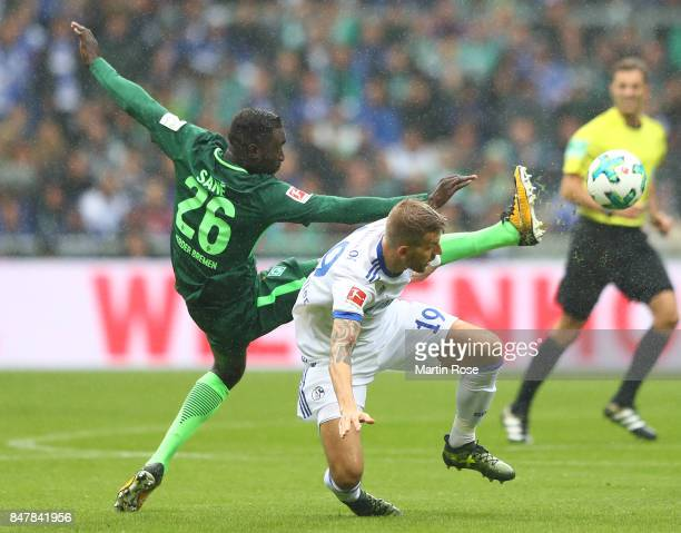 Lamine Sane of Bremen fights for the ball with Guido Burgstaller of Schalke during the Bundesliga match between SV Werder Bremen and FC Schalke 04 at...