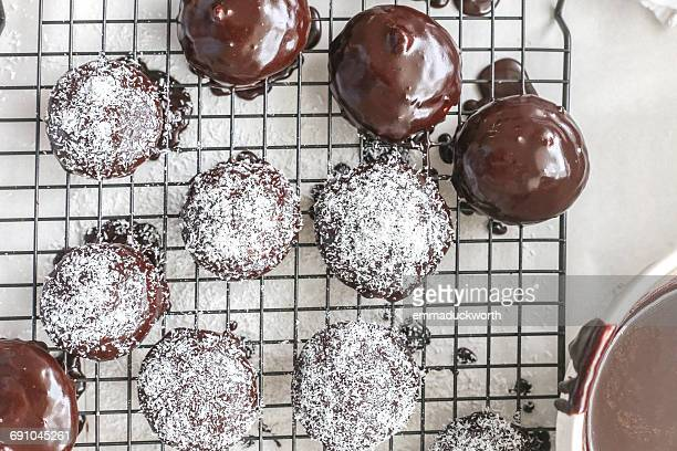 Lamington biscuits with coconut on a cooling rack