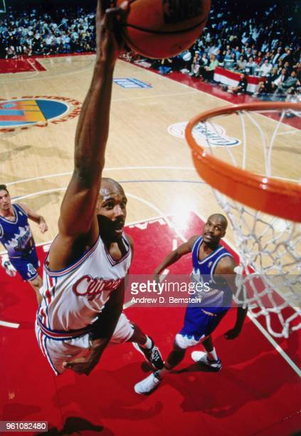 Lamond Murray of the LA Clippers dunks the ball against the Utah Jazz circa 1997 at the Los Angeles Memorial Sports Arena in Los Angeles, California....