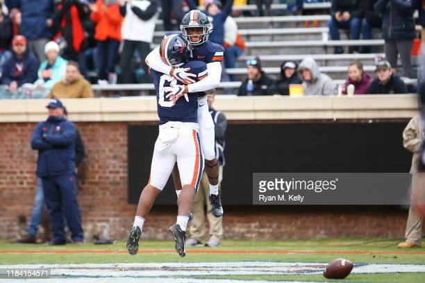 Lamont Atkins and PK Kier of the Virginia Cavaliers celebrate a touchdown in the first half during a game against the Liberty Flames at Scott Stadium...