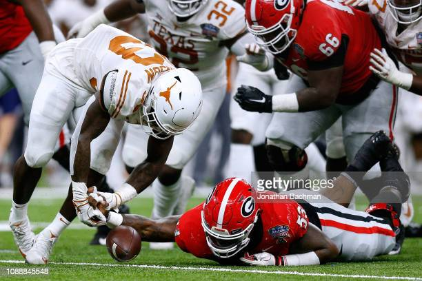Lamont Gaillard of the Georgia Bulldogs recovers a fumble over Gary Johnson of the Texas Longhorns during the first half of the Allstate Sugar Bowl...