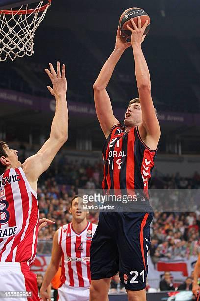 Lamont Hamilton, #11 of Laboral Kutxa Vitoria competes with Boban Marjanovic, #13 of Crvena Zvezda Telekom Belgrade in action during the 2013-2014...
