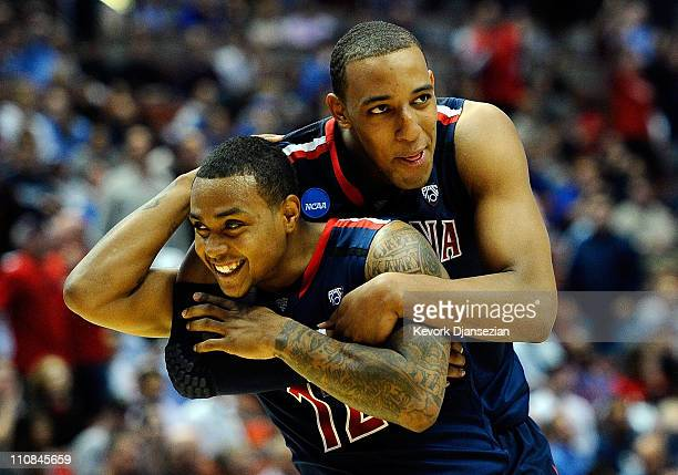 Lamont Jones and Derrick Williams of the Arizona Wildcats reacts after a play against the Duke Blue Devils during the west regional semifinal of the...
