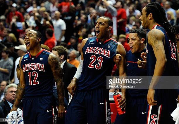 Lamont Jones and Derrick Williams of the Arizona Wildcats reacts from the bench after a play against the Duke Blue Devils during the west regional...