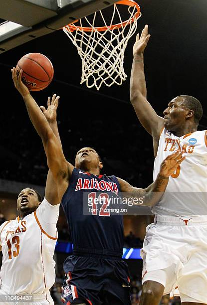 Lamont Jones of the Arizona Wildcats goes up for a shot against Tristan Thompson and Jordan Hamilton of the Texas Longhorns during the third round of...