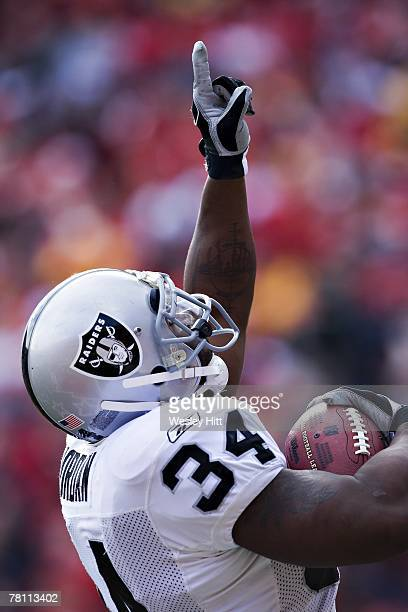 LaMont Jordan of the Oakland Raiders signals after scoring a touchdown against the Kansas City Chiefs at Arrowhead Stadium on November 25 2007 in...