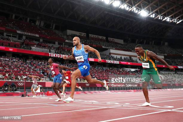 Lamont Marcell Jacobs of Team Italy celebrates after winning the Men's 100m Final on day nine of the Tokyo 2020 Olympic Games at Olympic Stadium on...