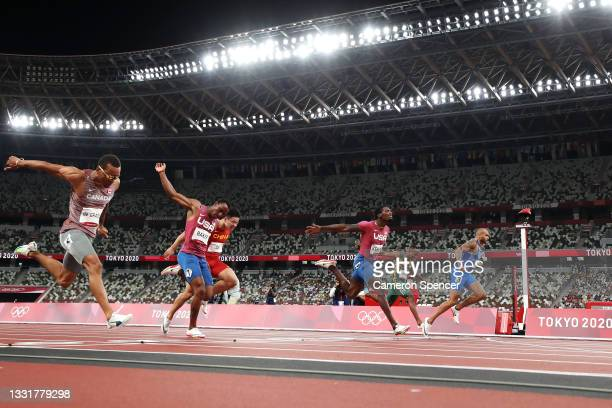 Lamont Marcell Jacobs of Team Italy wins the Men's 100m Final ahead of Fred Kerley of Team United States and Andre De Grasse of Team Canada on day...