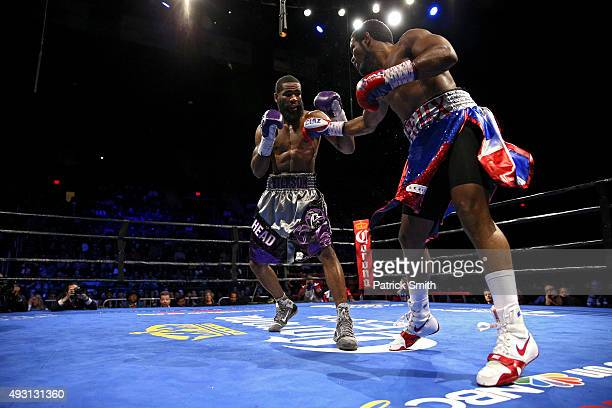 Lamont Peterson and Felix Diaz Jr exchange punches during their welterweight bout on the campus of George Mason University on October 17 2015 in...