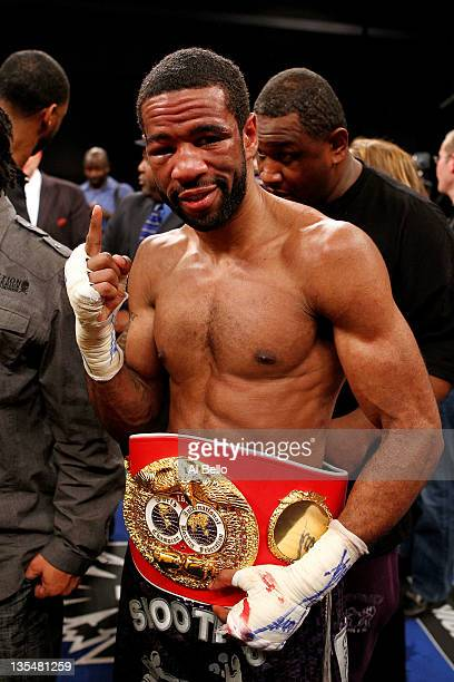 Lamont Peterson celebrates with the belt after defeating Amir Khan during the Capital Showdown Khan v Peterson WBA/IBF World lightwelterweight title...