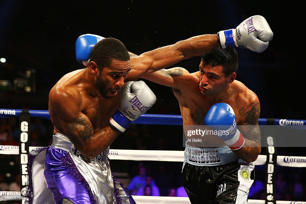 Lamont Peterson exchanges punches with Lucas Matthysse during their Welterweight fight at Boardwalk Hall Arena on May 18, 2013 in Atlantic City, New Jersey.