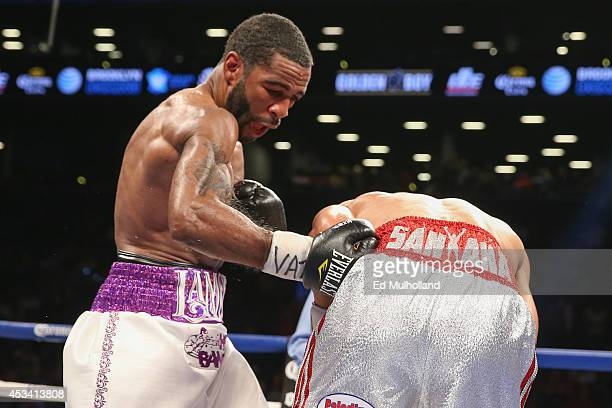 Lamont Peterson lands a body shot to Edgar Santana during their IBF junior welterweight championship fight at the Barclays Center on August 9 2014 in...