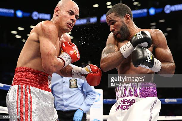 Lamont Peterson lands a right on Edgar Santana during their IBF junior welterweight championship fight at the Barclays Center on August 9 2014 in...