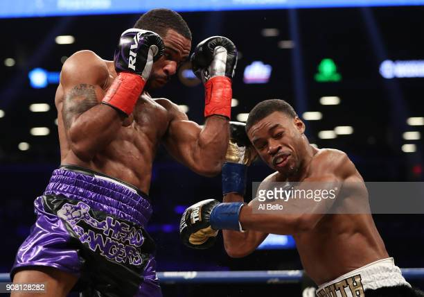 Lamont Peterson punches Errol Spence during their IBF Welterweight title fight at the Barclays Center on January 20 2018 in New York City