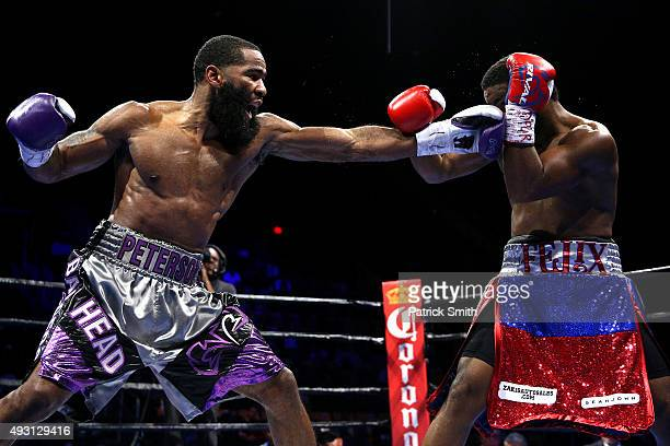 Lamont Peterson punches Felix Diaz Jr during their welterweight bout on the campus of George Mason University on October 17 2015 in Fairfax Virginia...