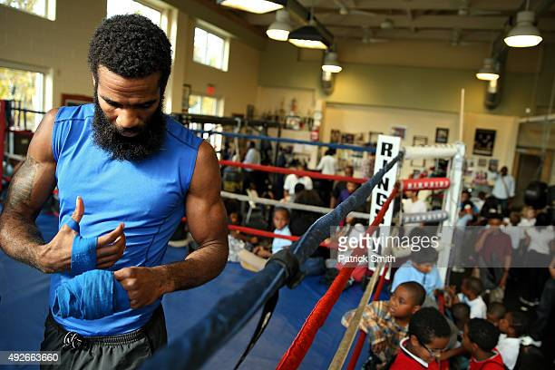 Lamont Peterson removes hand wrap during fighter media workouts in the Alexandria Boxing Club at the Charles Houston Recreation Center on October 14...