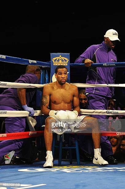 Lamont Peterson sits in his corner between rounds against Dierry Jean in their IBF Junior Welterweight World Championship match at the DC Armory on...