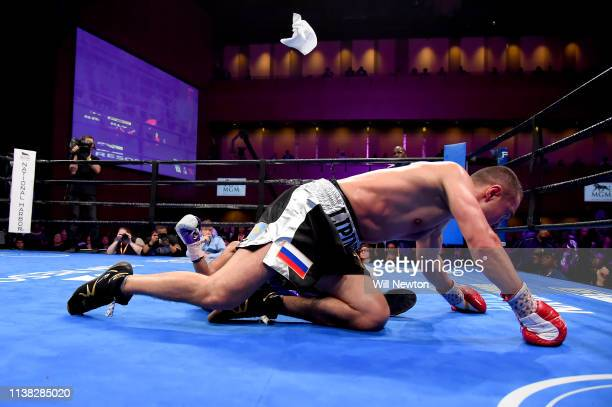 Lamont Peterson's corner throws in the towel after he is knocked down by Sergey Lipinets at The Theater at MGM National Harbor on March 24 2019 in...
