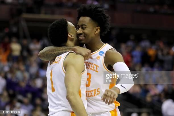 Lamonte Turner and Jordan Bowden of the Tennessee Volunteers react after defeating the Iowa Hawkeyes 8377 in the Second Round of the NCAA Basketball...