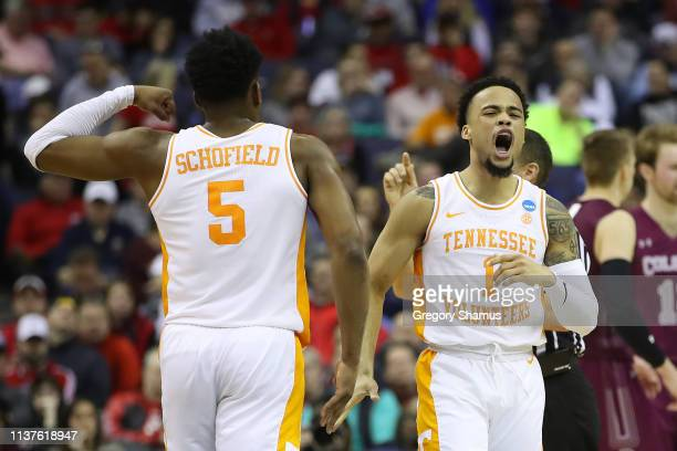Lamonte Turner celebrates with Admiral Schofield of the Tennessee Volunteers during the first half against the Colgate Raiders in the first round of...