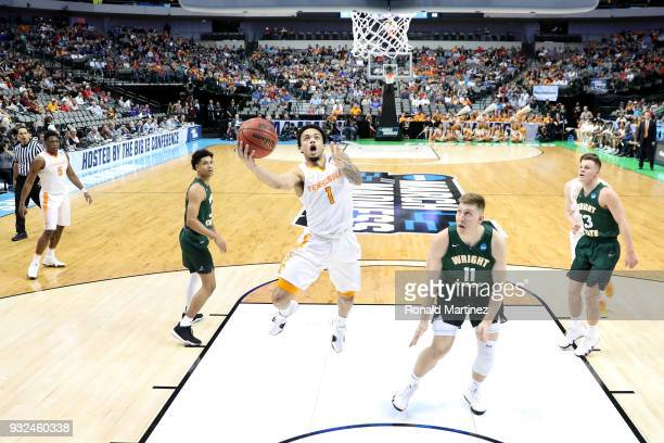 Lamonte Turner of the Tennessee Volunteers goes up for a shot against Loudon Love of the Wright State Raiders in the first half in the first round of...