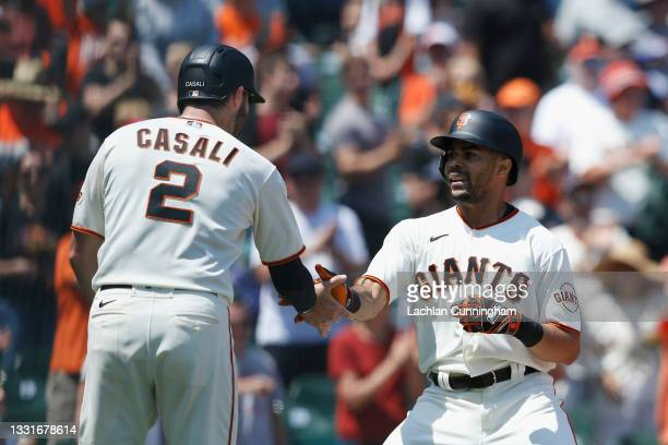 LaMonte Wade Jr of the San Francisco Giants celebrates with Curt Casali after hitting a two-run home run in the bottom of the fourth inning against...