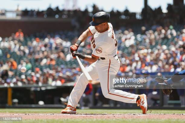 LaMonte Wade Jr of the San Francisco Giants hits a solo home run in the bottom of the first inning against the Chicago Cubs at Oracle Park on June...
