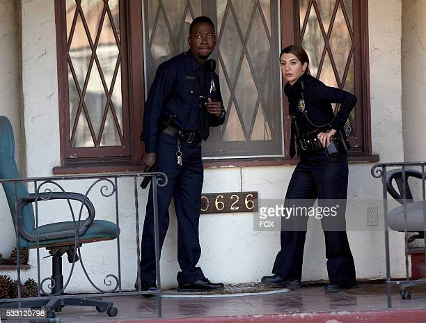"""Lamorne Morris and guest star Nasim Pedrad in the """"D-Day"""" episode of NEW GIRL airing Tuesday, March 22 on FOX."""