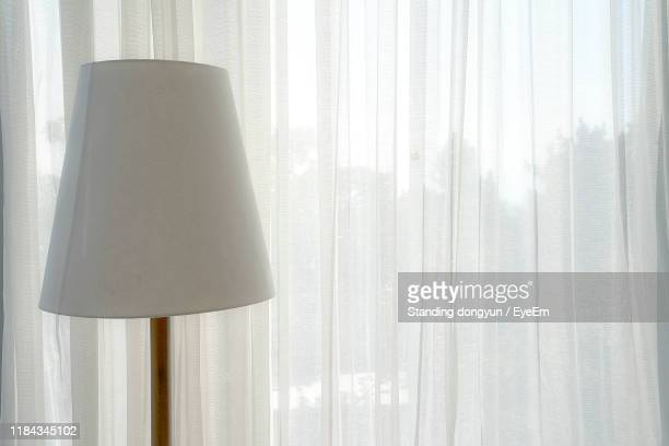 lamp against white curtain at home - translucent stock pictures, royalty-free photos & images