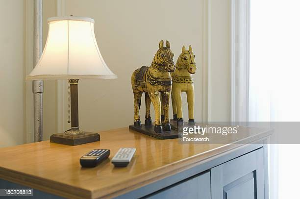 Lamp and decorative horses on dresser
