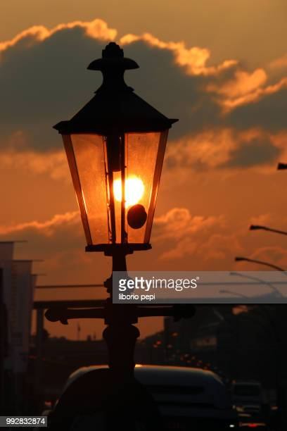 lamp at the sunset - liborio pepi stock-fotos und bilder