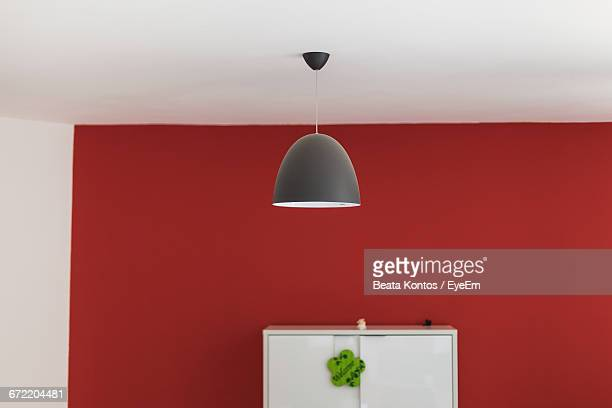 Lamp Hanging At Ceiling Of Home