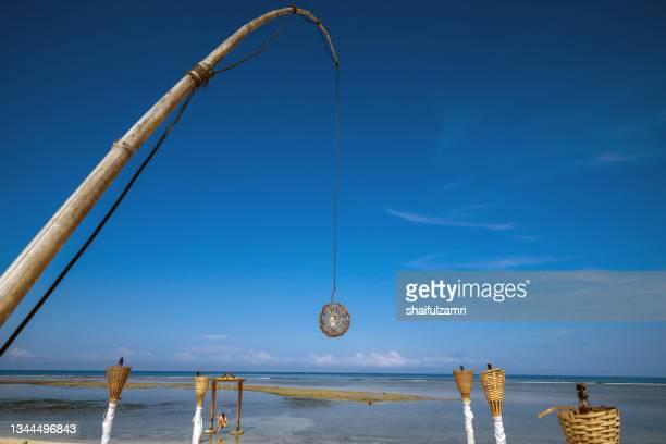 led lamp hanging in bamboo pole - a deco art at beach near lombok, indonesia - shaifulzamri - fotografias e filmes do acervo