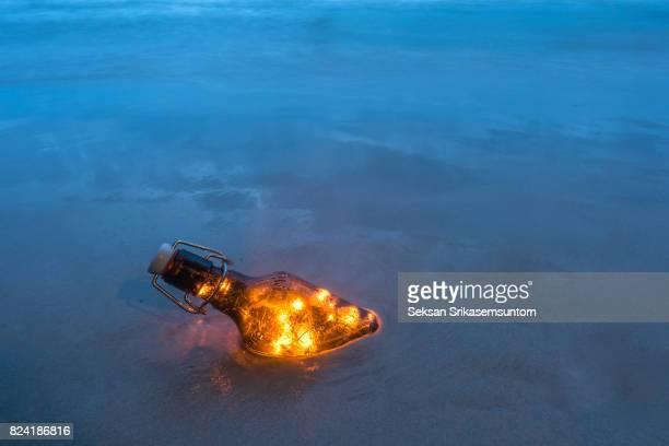 Lamp in Bottle on Beach