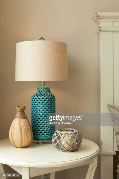 lamp on table in bedroom - lamp stock photos and pictures