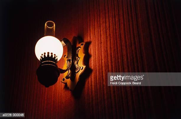 lamp on wall - heidi coppock beard stock-fotos und bilder