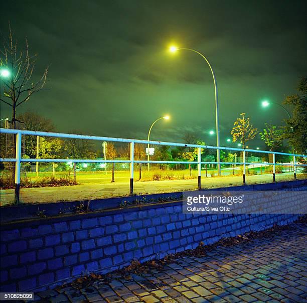 Lamp post and bridge at night