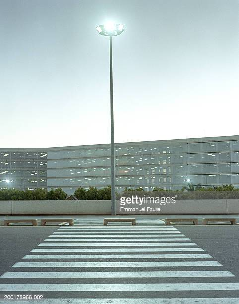 Lamp post and crosswalk of airport
