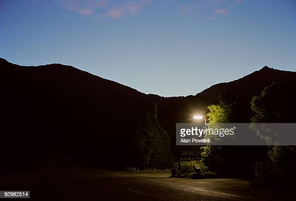 Lamp post and mountains