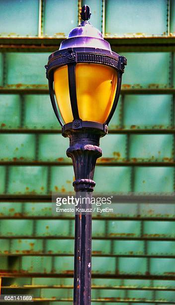 lamp post below metallic bridge - krausz stock-fotos und bilder
