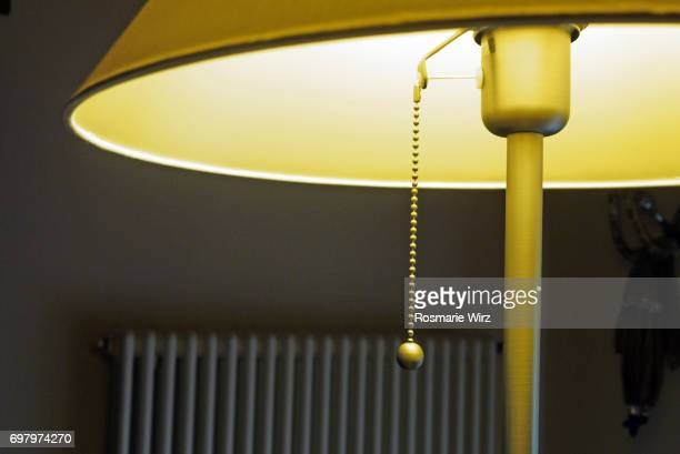 lamp shade, with light on, partial side view. - lamp stock-fotos und bilder