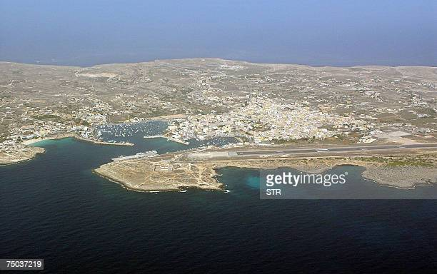 --Picture taken 10 October 2004 shows an aerial view of Italy's Lampedusa island with its urban centre, harbour and airport. Some 210 illegal...