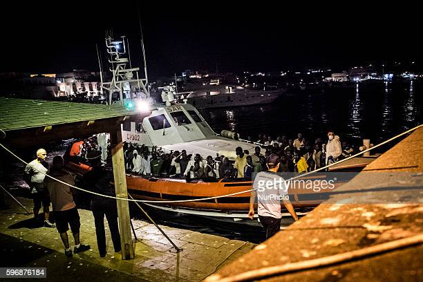 Lampedusa midnight between august 27h and 28th Migrants rescued by the Italian Coast Guard disembark at the Favarolo peer