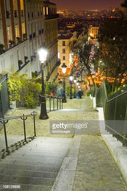 Lamplight, cafes and steep steps, Paris