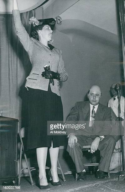 Lampooners -- Frances Melorse as Alma Schneider and Bill Scott, artist for The Denver Post, portraying Senator Eugene D. Millikin, appear in a skit...