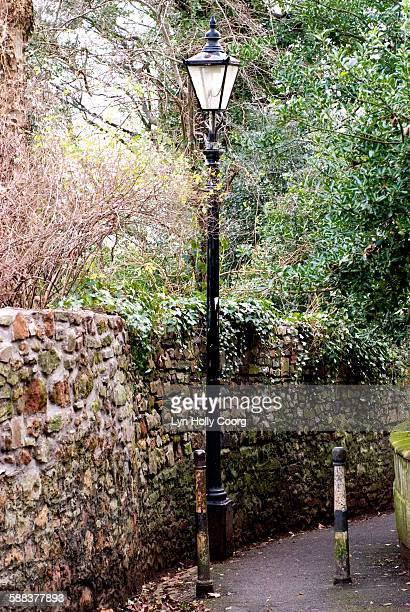 lampost in lane with stone wall - lyn holly coorg stock pictures, royalty-free photos & images