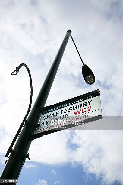 lamppost and sign, london, england - shaftesbury avenue london stock photos and pictures