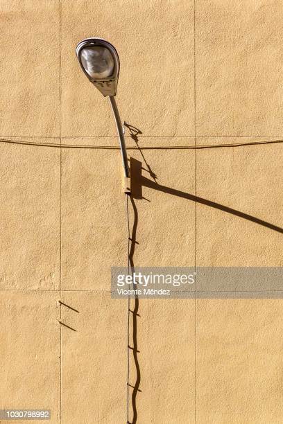 Lamppost on the wall