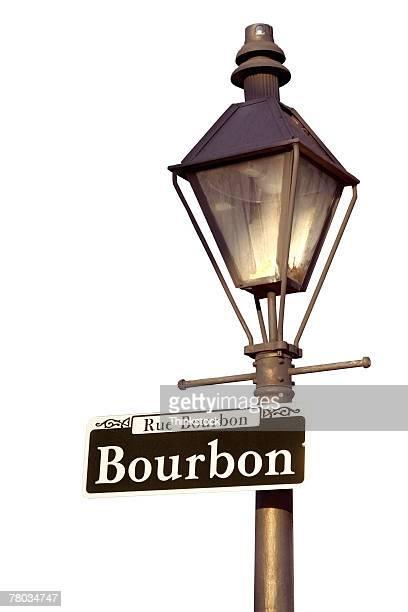 lamppost with bourbon street sign, new orleans, louisiana - thinkstock foto e immagini stock